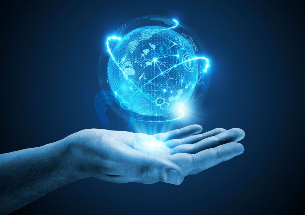 hand with a technology globe above
